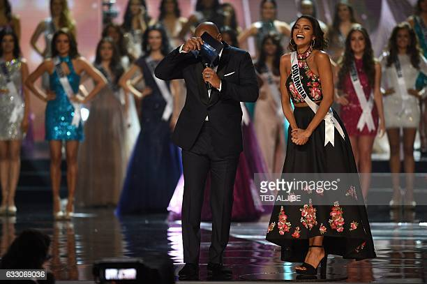 Miss Universe candidate Andrea Tovar of Colombia laughs as she answers a question from pageant host Steve Harvey of the US during the finals of the...
