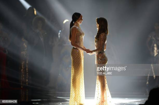 TOPSHOT Miss Universe candidate Iris Mittenaere of France holds hands with Raquel Pelissier of Haiti prior to the announcement of the winner during...