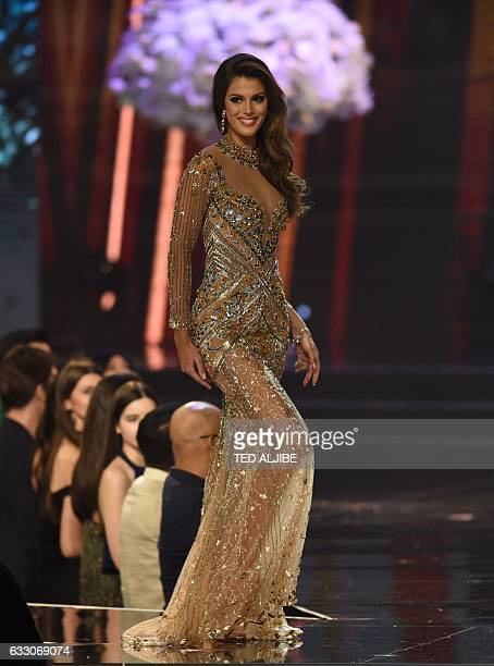 Miss Universe candidate Iris Mittenaere of France parades in her long gown on stage during the finals of the Miss Universe pageant at the Mall of...