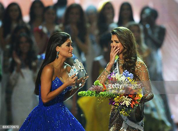 Miss Universe candidate Iris Mittenaere of France reacts after winning the title while former Miss Universe Pia Wurzbach of the Pilippines prepares...