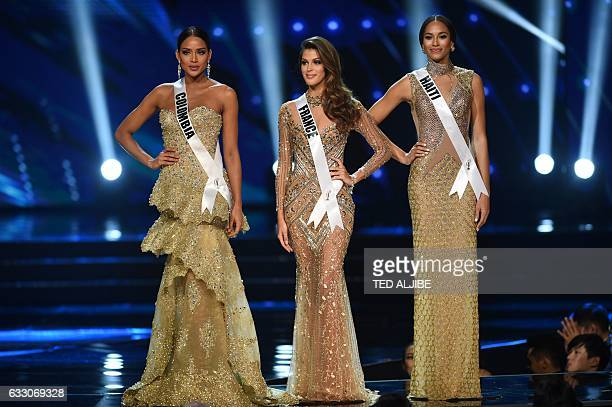 Miss Universe candidates Andrea Tovar of Colombia Iris Mittenaere of France and Raquel Pelissier of Haiti stand on stage as they wait for the...