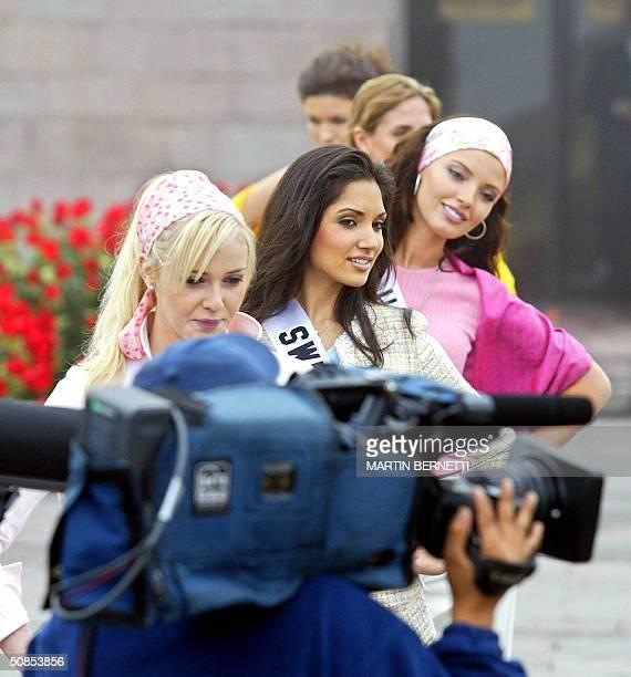 Miss Universe candidates Miss Canada Venessa Fisher Miss Switzerland Bianca Sissing and Miss Ukraine Oleksandra Nikolayenko pose for TV cameramen in...