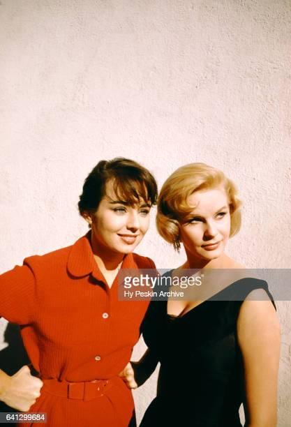 Miss Universe Carol Morris and Miss Sweden Ingrid Goude pose for a portrait on November 7 1955