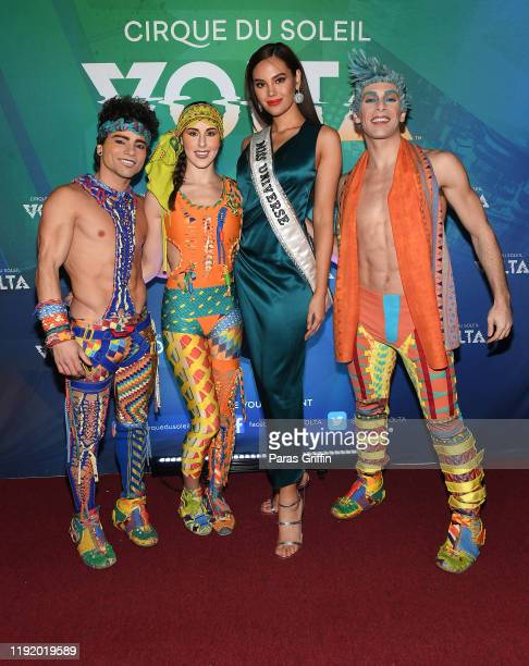 Miss Universe Catriona Gray poses with cast members of Volta during Volta By Cirque Du Soleil at Atlantic Station on December 04 2019 in Atlanta...