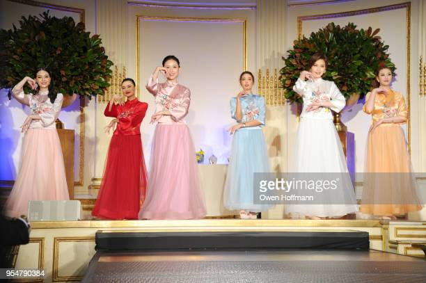 Miss Universe China winners Joyce Li Jin Ye Jessica Xue Roseline Luo Diana Xu and Karen Hu perform onstage during the 2018 China Fashion Gala at The...