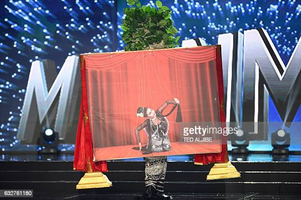 Miss Universe contestant Htet Htet Htun of Myanmar performs a puppetry during the national costume and preliminary competition of the Miss Universe...