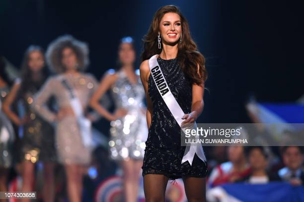 Miss Universe contestant Marta Stepien of Canada reacts after being selected as top 10 finalist during the 2018 Miss Universe Pageant in Bangkok on...