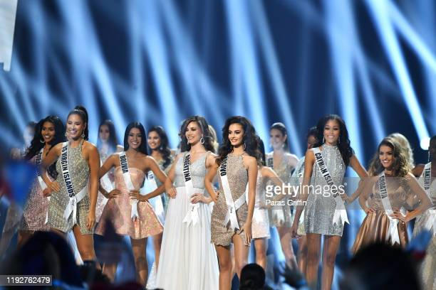 2019 Miss Universe contestants appear onstage at the 2019 Miss Universe Pageant at Tyler Perry Studios on December 08 2019 in Atlanta Georgia