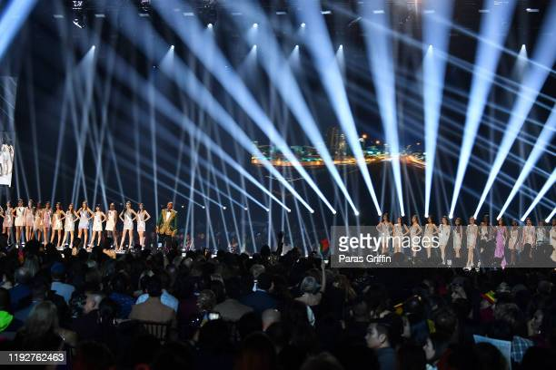 Miss Universe contestants appear onstage with host Steve Harvey at the 2019 Miss Universe Pageant at Tyler Perry Studios on December 08, 2019 in...
