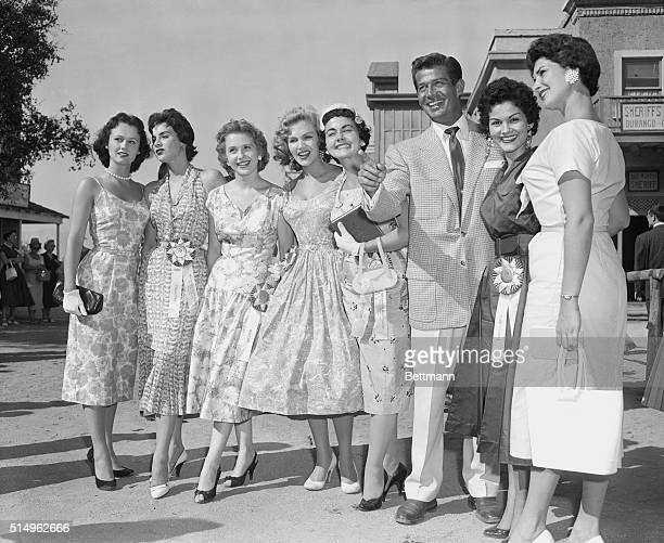 Miss Universe contestants visit UniversalInternational Studios in Hollywood and are shown the sights by actor George Nader Left to right the lovelies...
