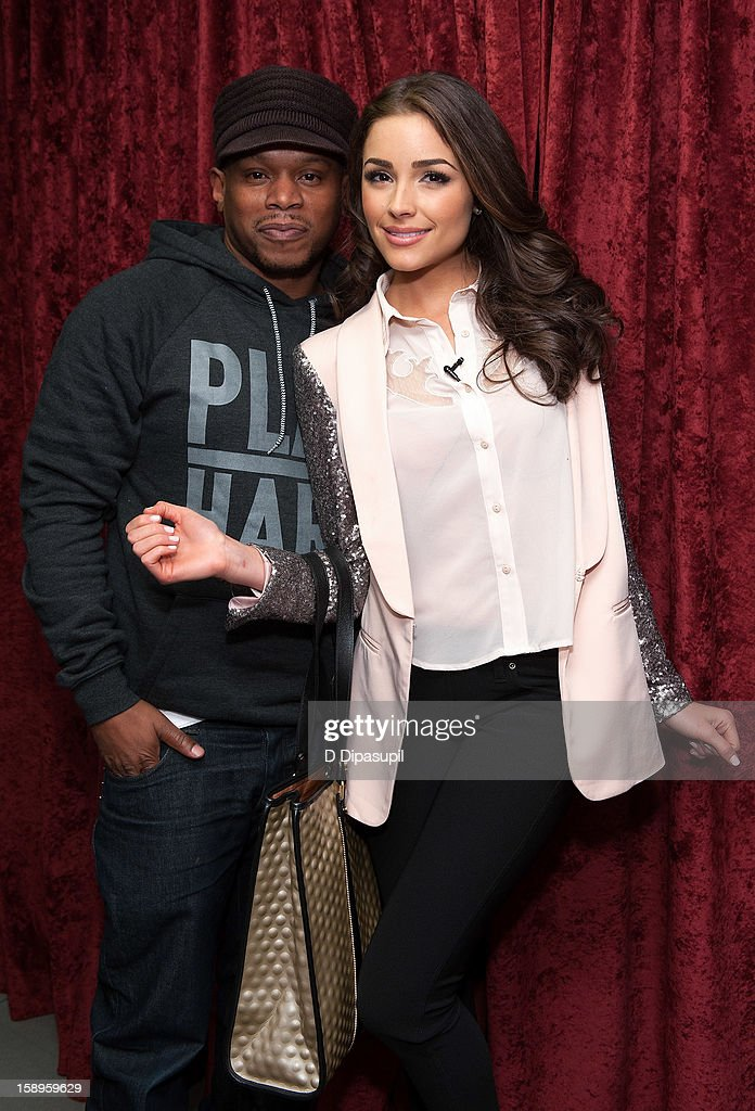 Miss Universe Olivia Culpo (R) poses with host Sway Calloway during her visit to 'Sway in the Morning'on EminemÕs Shade 45 channel in the SiriusXM studios on January 4, 2013 in New York City.