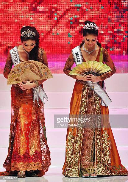 Miss Universe Riyo Mori of Japan and Miss Indonesia 2006 Agni Prakistha appear on stage during the Miss Indonesia 2007 pageant in Jakarta early 04...