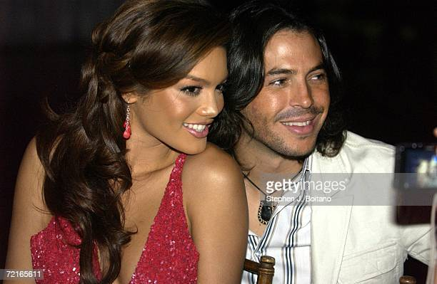 Miss Universe Zuleyka Rivera and Jorge Moreno pose for photos at the Youth Aids Gala on October 13 2006 in McLean Virginia YouthAIDS will host its...