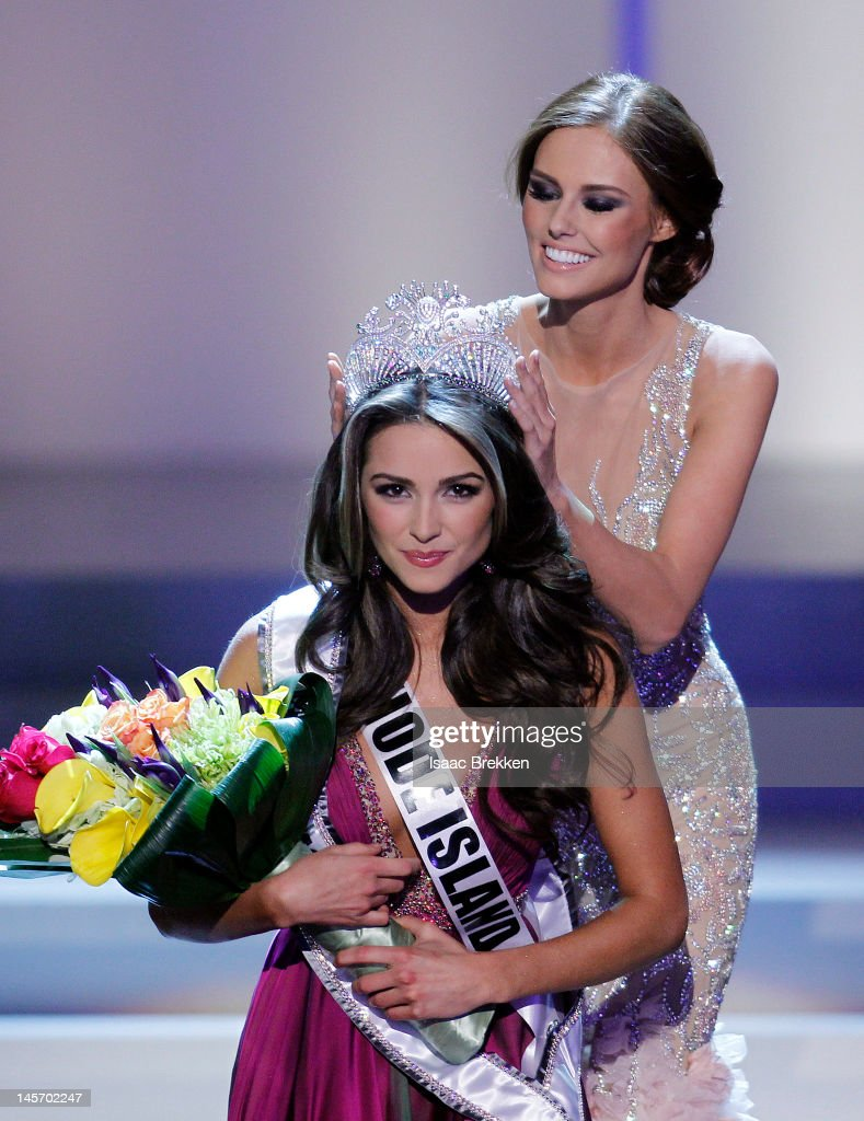 Miss USA 2011 Alyssa Campanella crowns Miss Rhode Island USA Olivia Culpo the 2012 Miss USA during the 2012 Miss USA pageant at the Planet Hollywood Resort & Casino on June 3, 2012 in Las Vegas, Nevada.