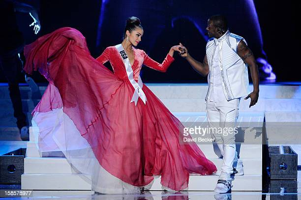 Miss USA 2012 Olivia Culpo is escorted by singer/songwriter and dancer Timomatic during the 2012 Miss Universe Pageant at PH Live at Planet Hollywood...