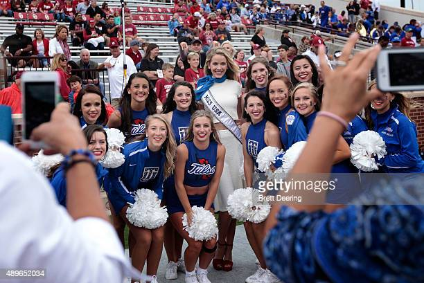Miss USA 2015 Olivia Jordan poses with the Tulsa Golden Hurricane cheerleaders during the game against the Oklahoma Sooners September 19 2015 at...
