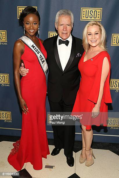 Miss USA Deshauna Barber 'Jeopardy' host Alex Trebek and country music star Kellie Pickler attend the 2016 USO Gala on October 20 2016 at DAR...