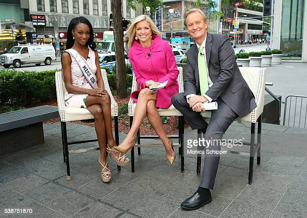 Miss USA Deshauna Barber poses for a photo with Fox Friends hosts Ainsley Earhardt and Steve Doocy when she visits Fox Friends on June 8 2016 in New...