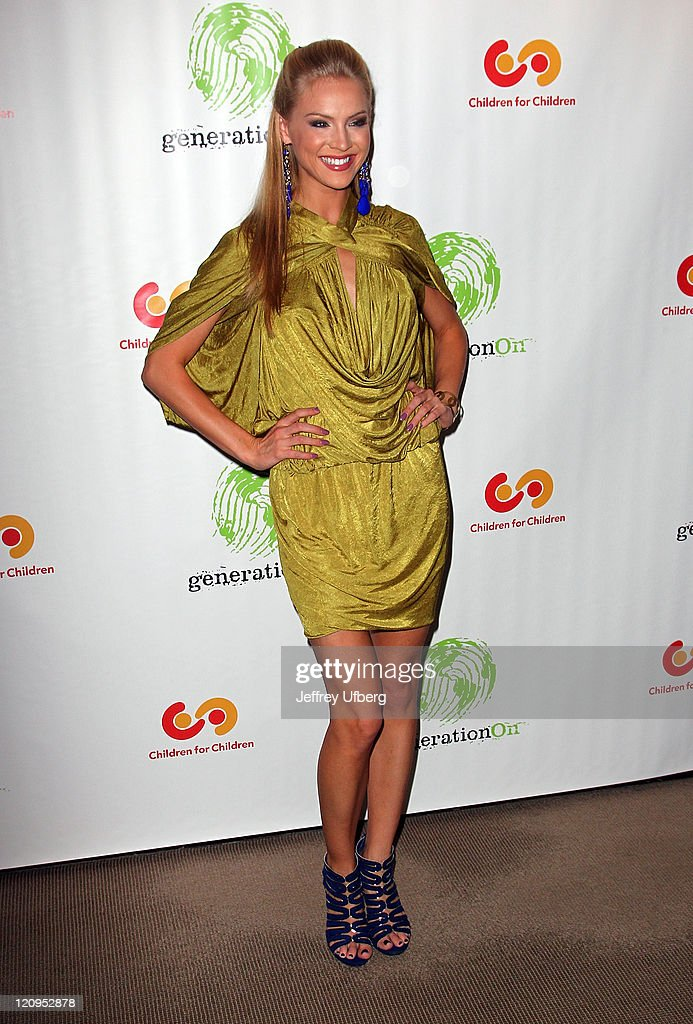 Miss USA Kristen Dalton attends the 9th annual The Art Of Giving benefit by Children For Children at Christie's on April 13, 2010 in New York City.