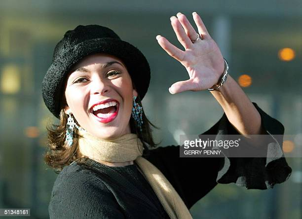 Miss USA Rebekah Revels waves to the crowd upon her arrival at Gatwick Airport 24 November 2002 Miss World contestants arrived in London on Sunday...