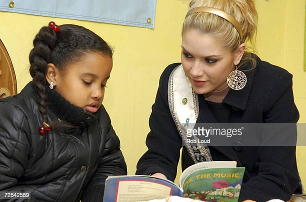 Miss USA Tara Conner reads with Gabriella Alix at the St Luke's Roosevelt Outpatient clinic November 14 2006 in New York City
