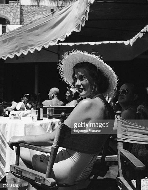 Miss Utler Gisela lounges by the pool at La Canzone del Mare a restaurant owned by singer Gracie Fields on the island of Capri 11th August 1952