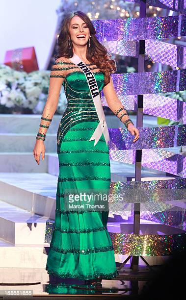 Miss Venezuela 2012 Irene Sofia Esser Quintero reacts after being selected as one of the five finalists during the 2012 Miss Universe Pageant at...