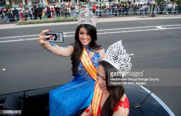 Miss Vietnam of Southern California Anne Phung Nguyen snaps a selfie next to her successor Diem Nguyen right as the annual Tet Parade kicks off in...