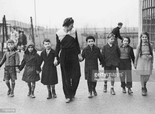 Miss W Herford takes a group of Jewish refugee children for a walk at Dovercourt camp near Harwich 11th January 1939 Miss Herford also interviews...