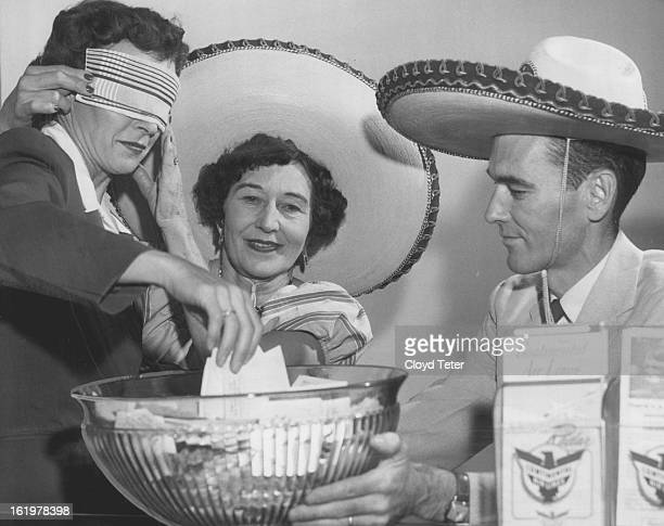 SEP 13 1956 SEP 14 1956 SEP 16 1956 Miss Wilton McCoy counter sales agent at the Continental Air Lines downtown ticket office draws the winner of the...