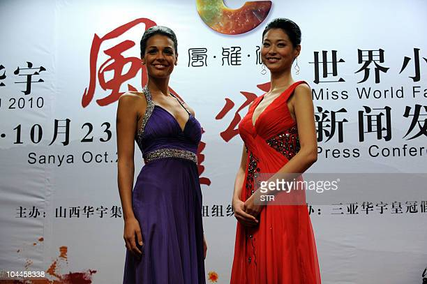 Miss World 2009 Kaiane Aldorino of Gibraltar poses with Miss China 2010 Tang Xiao during a press conference in Beijing on September 25 to announce...