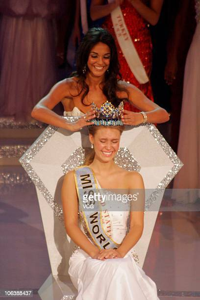Miss World 2010 Alexandria Mills of the United States is crowned by the 59th Miss World Kaiane Aldorino after winning the 60th Miss World Beauty...
