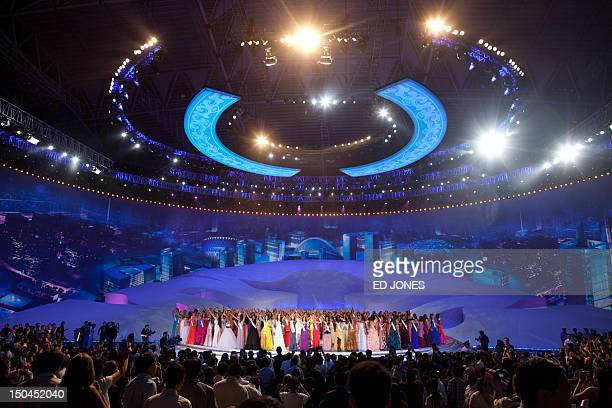 Miss World 2012 contestants wave following the pageant's final ceremony at the Ordos Stadium Arena in the inner Mongolian city of Ordos on August 18...