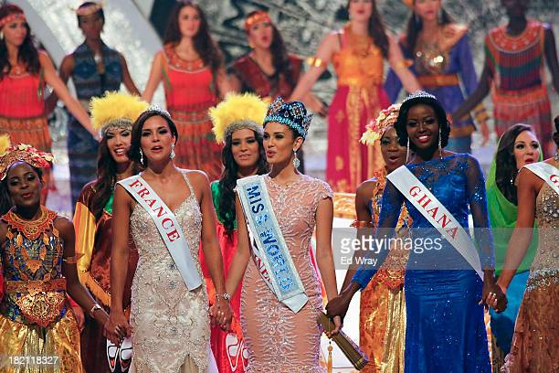Miss World 2013 Megan Young from the Philippines sings with runnerup Miss France Marine Lorphelin and second runnerup Miss Ghana Carranzar Naa...