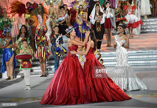 Miss World 2014 Rolene Strauss wears 2nd place crown for Sofia Nikitchuk of Russia during the Miss World Grand Final on December 19 2015 in Sanya...