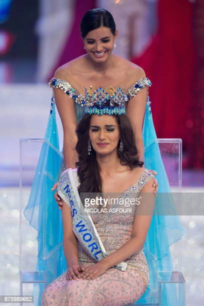 Miss World 2016 Stephanie Del Valle comforts an emotional Miss India Manushi Chhilar after she won the 67th Miss World contest final in Sanya on the...
