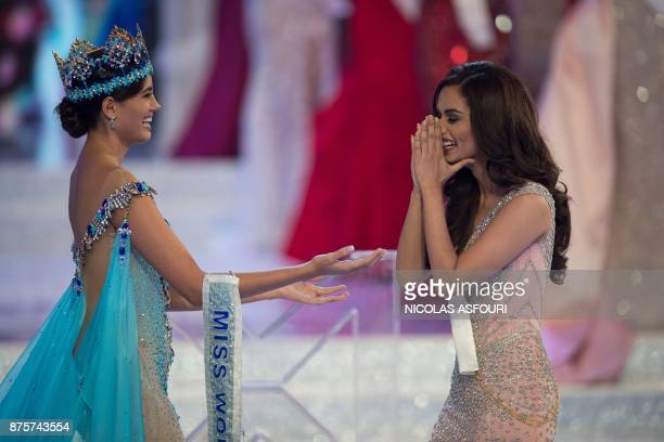 Miss World 2016 Stephanie Del Valle congratulates Miss India Manushi Chhilar after she wins the 67th Miss World contest final in Sanya on the...