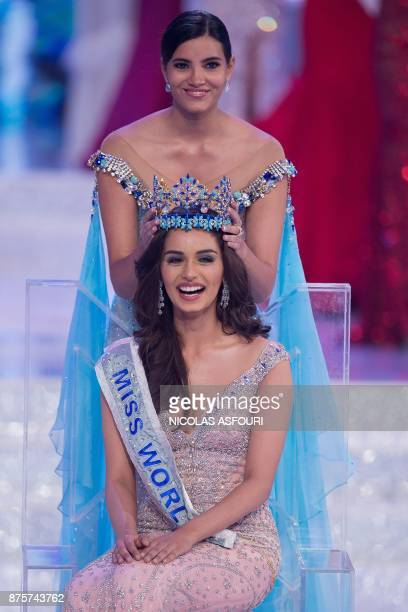 Miss World 2016 Stephanie Del Valle put the crown on Miss India Manushi Chhilar after she wins the 67th Miss World contest final in Sanya on the...
