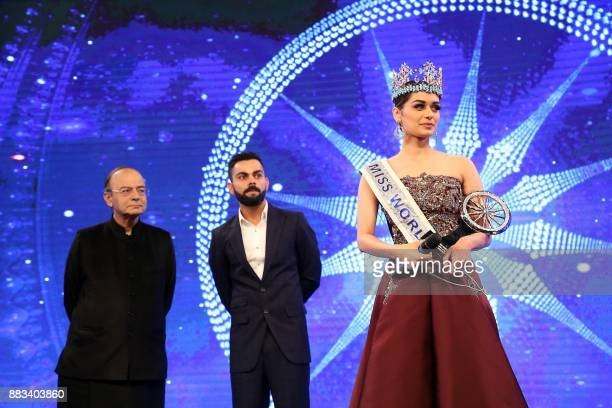 Miss World 2017 Manushi Chhillar holds up the CNNIBN Special Achievement Award during an awards ceremony in New Delhi on November 30 2017 / AFP PHOTO...