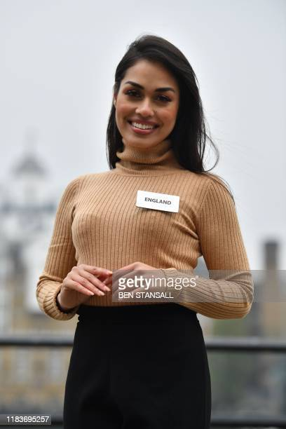 Miss World 2019 contestant Miss England Bhasha Mukherjee poses during a photo call for the 69th Miss World festival and final in London on November...