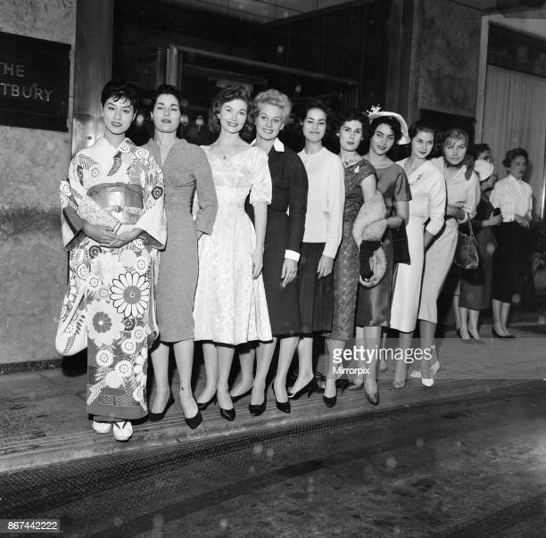 Miss World Beauty Contestants, pictured standing together outside their hotel, The Westbury, London, 5th October 1958. From left to right, Miss Japan...