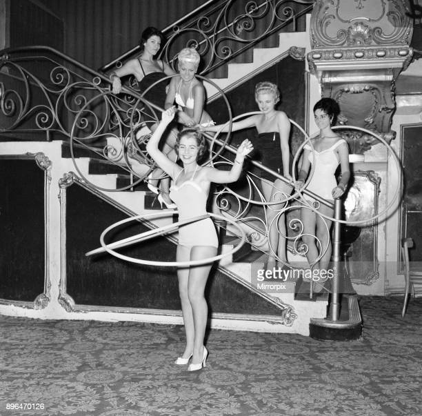 Miss World Beauty Contestants, try out hula hoops at The Lyceum Theatre, London, 7th October 1958. Miss Norway Ase Qjeldvik performs with two hoops,...