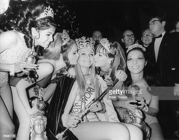 Miss World competition at the Royal Albert Hall London L to r 4th Miss Guyana 2nd Miss USA winner Miss Austria 3rd Miss Germany kissing the winner...