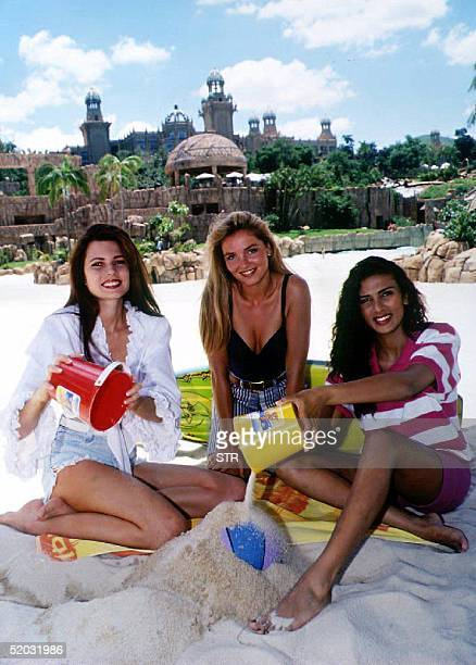 Miss World Contestants build castles on the beach in South Africa 16 November 1993 From LR are Miss Colombia Silvia Isabel Duran Angarita Miss...