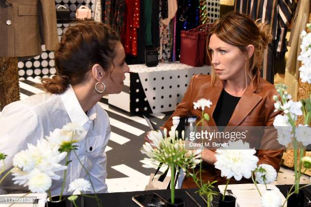 Misse Beqiri and Abbey Clancy attend the launch of the British Fashion Council designer popup store at Bicester Village on October 09 2019 in...