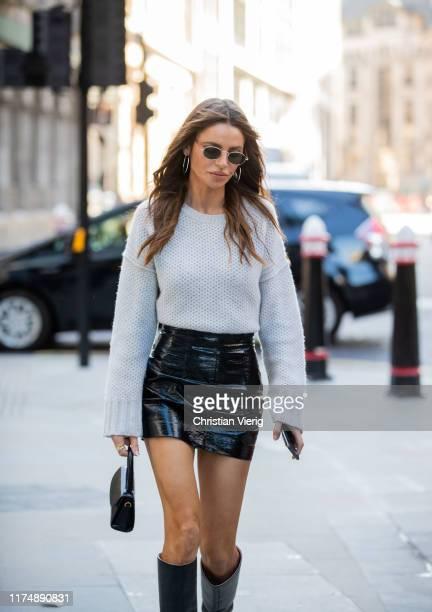 Misse Beqiri is seen wearing black mini skirt knit outside David Koma during London Fashion Week September 2019 on September 15 2019 in London England