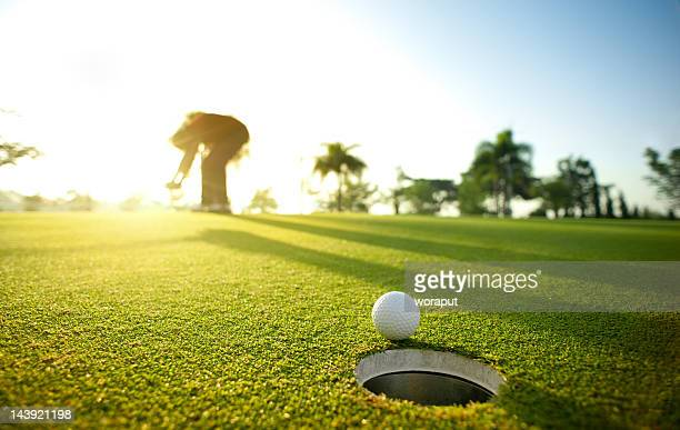 missed putt - hitting stock pictures, royalty-free photos & images