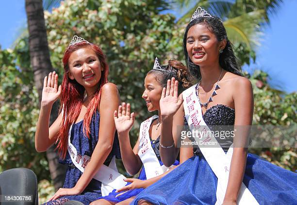 Misses waiving at the Flower Parade in Oahu, during the Aloha Festivals. Aloha Festivals celebrate Hawaiian culture, music, dance, history and...