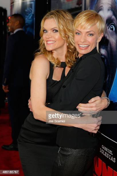 Missi Pyle and Jaime Pressly walk the 'A Haunted House 2' Los Angeles Premiere Red Carpet at Regal Cinemas LA Live on April 16 2014 in Los Angeles...