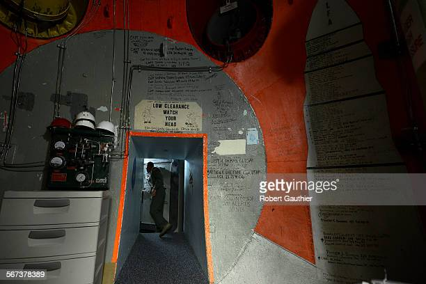 FALLS MONTANA 2014 Missile combat crew member 2nd Lt Wesley Griffith prepares to close a three foot thick door inside a launch control center at...